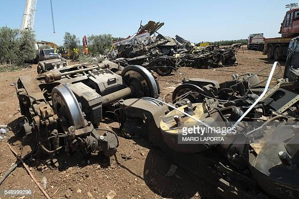 Remains of the train crash site lie on the ground on July 13 2016 near Corato in the southern Italian region of Puglia as rescuers searched for...
