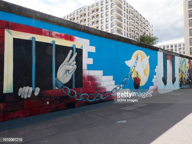 Remains of the wall that were painted by artists from all over the world in 1990 The Berlin Wall was built by Soldiers in Bernauer Strasse to divide...