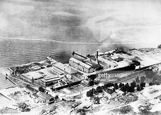 Remarkable aerial view of Sing Sing the New York State Prison at Ossining NY taken by an Army photographer showing the grey buildings with their...