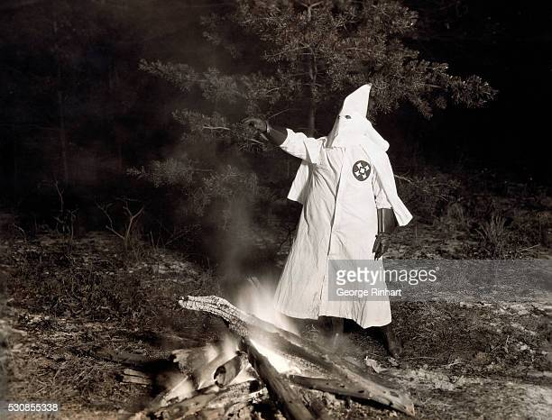 Remarkable photograph made in the open somewhere in Maryland showing the grand goblin of the district organization of the Ku Klux Klan presiding over...
