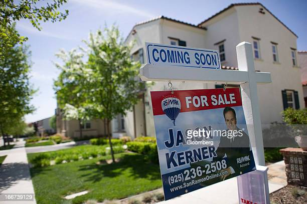 A Remax LLC 'For Sale' sign is displayed in front of a home in San Ramon California US on Friday April 12 2013 Newhome construction in the US jumped...