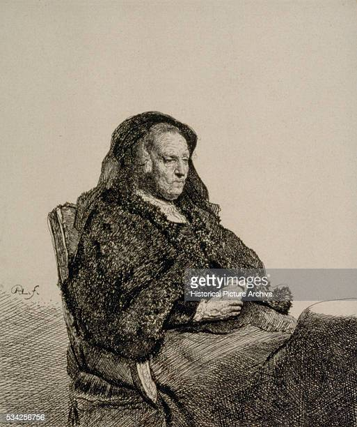 Rembrandt's Mother Seated at a Table by Rembrandt Harmensz van Rijn
