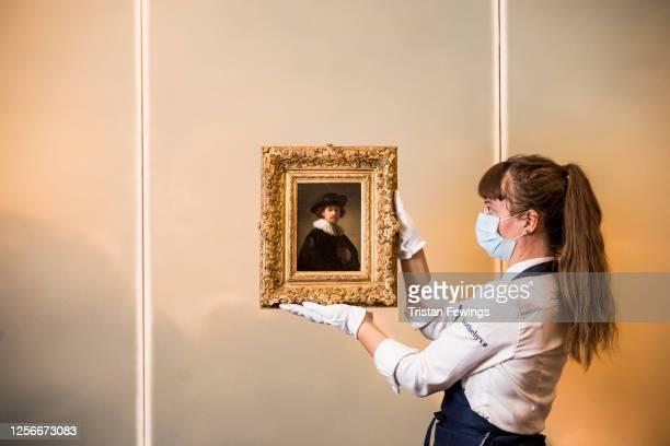Rembrandt's Self-portrait of the artist, half-length, wearing a ruff and a black hat est. £12-16 million and Gerhard Richter's 'Wolken ' est. £9-12...
