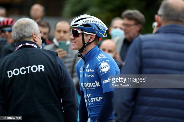 Remco Evenepoel of Belgium and Deceuninck-Quick-Step team talks with the doctor who rescued him during the last year edition of the race during the...