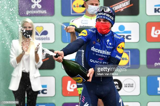 Remco Evenepoel of Belgium and Team Deceuninck - Quick-Step celebrates winning on the podium ceremony after the 101st Brussels Cycling Classic 2021 a...