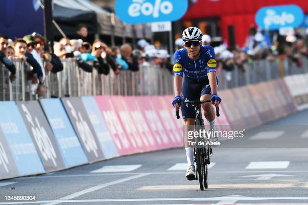 Remco Evenepoel of Belgium and Team Deceuninck - Quick-Step crosses the finishing line during the 115th Il Lombardia 2021 a 239km race from Como to...