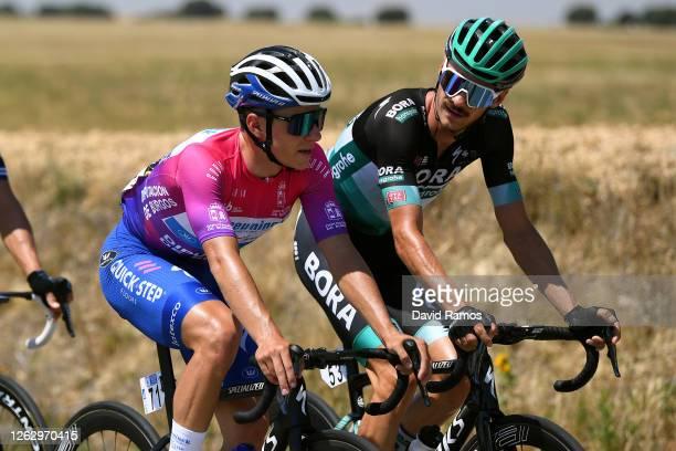 Remco Evenepoel of Belgium and Team Deceuninck - Quick-Step Purple Leader Jersey / Felix Grossschartner of Austria and Team Bora-Hansgrohe / during...