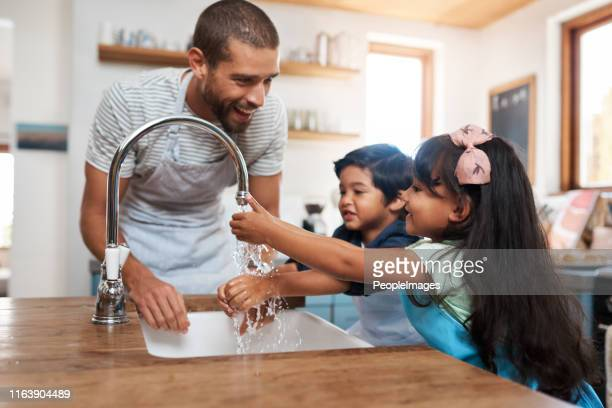 remember to get in between your fingers - washing hands stock pictures, royalty-free photos & images