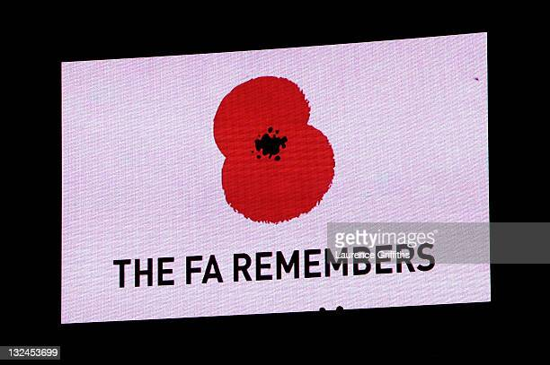 Rememberance Day message is displayed on the scoreboard prior the international friendly match between England and Spain at Wembley Stadium on...