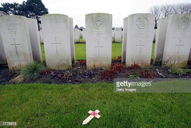 A remembrance cross lies in the cemetery for British soldiers killed in France during World War II February 11 2003 in Dunkirk France Recent...