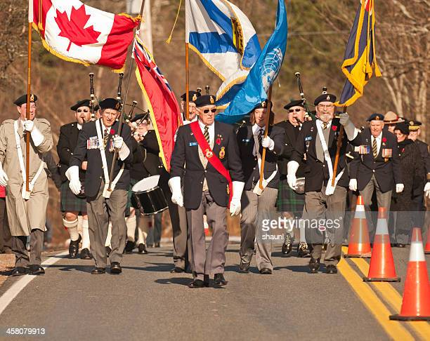 remembrance day parade - flag of nova scotia stock pictures, royalty-free photos & images