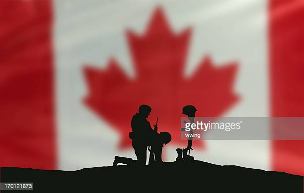 remembrance day soldier - soldier praying stock photos and pictures