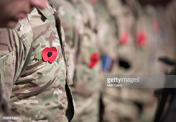 Remembrance poppies adorn uniforms as British troops and service personal remaining in Afghanistan are joined by International Security Assistance...