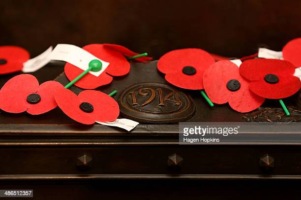 Remembrance poppies cover the shrine inside the Cenotaph during dawn service at the Wellington Cenotaph on April 25 2014 in Wellington New Zealand...
