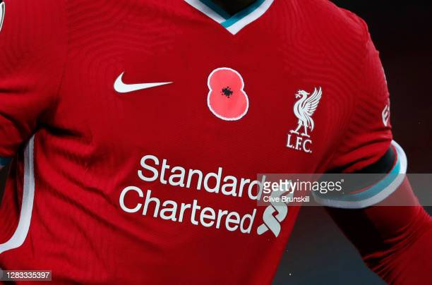 A remembrance Poppy is seen on the chest of Joe Gomez of Liverpool during the Premier League match between Liverpool and West Ham United at Anfield...
