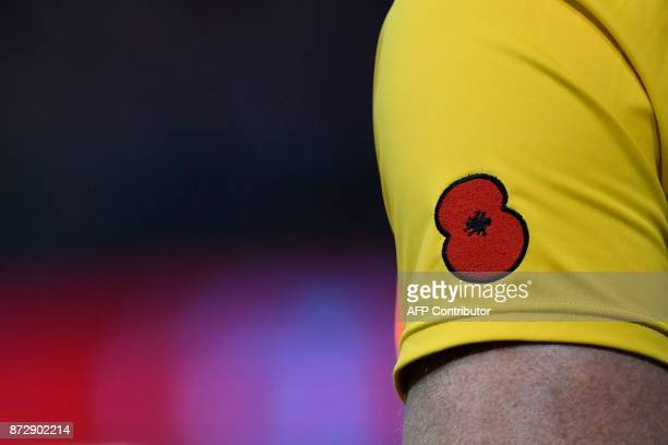 A remembrance poppy is seen on the jersey of an Austalian player during the rugby union international Test match between Wales and Australia at the...