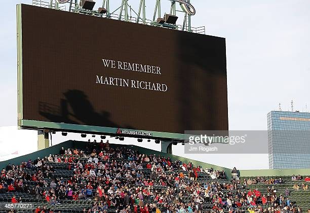 A remembrance to Martin Richard who died in 2013 Boston Marathon bombing is displayed during a ceremony at Fenway Park before a game between Boston...