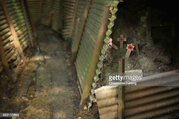 Remembrance tributes sit inside the preserved World War One trench system in 'Sanctuary Wood' on August 3 2014 in Ypres Belgium Monday 4th August...