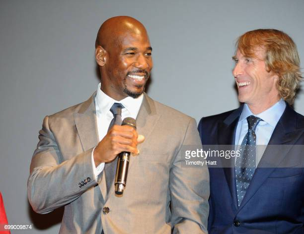 Remi Adeleke and Michael Bay speak onstage at the US premiere of Transformers The Last Knight at the Civic Opera House on June 20 2017 in Chicago...