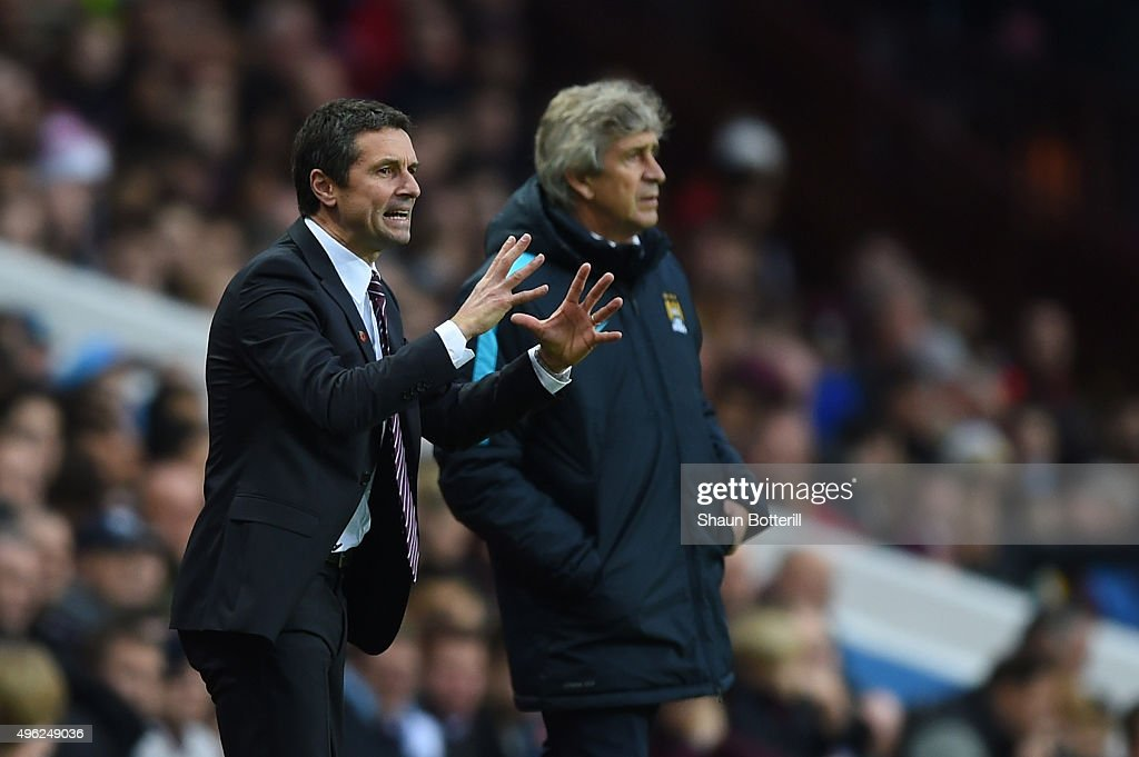 Remi Garde, Manager of Aston Villa directs his players as Manuel Pellegrini the manager of Manchester City looks on during the Barclays Premier League match between Aston Villa and Manchester City at Villa Park on November 8, 2015 in Birmingham, England.
