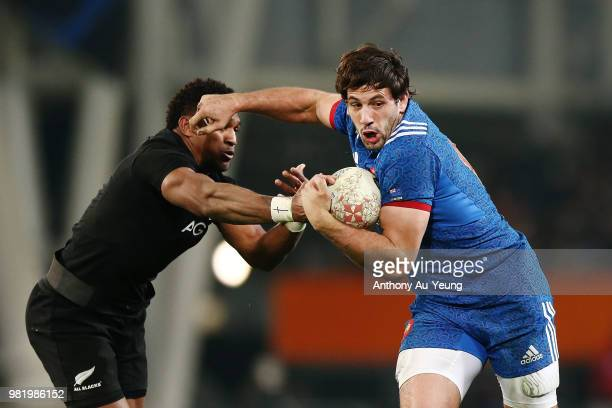 Remi Lamerat of France fends against Waisake Naholo of the All Blacks during the International Test match between the New Zealand All Blacks and...