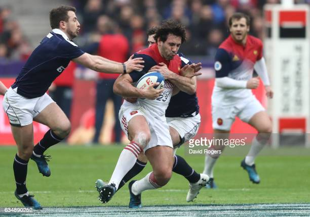 Remi Lamerat of France is tackled by Greig Laidlaw and Alex Dunbar of Scotland during the RBS Six Nations match between France and Scotland at Stade...