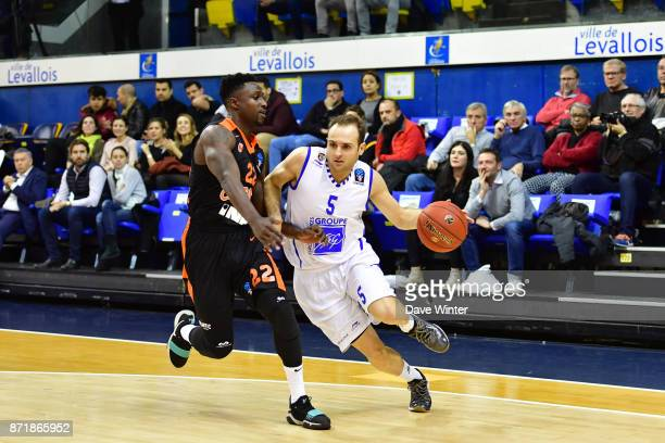 Remi Lesca of Levallois takes on Will Cherry of Cedevita Zagreb during the EuropCup match between Levallois Metropolitans and Cedevita Zagreb at...