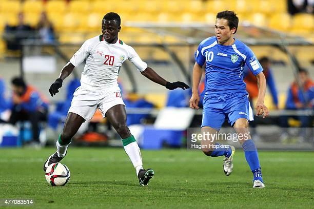Remi Nassalan of Senegal hold off the challenge of Otabek Shukurov of Uzbekistan during the FIFA U20 World Cup New Zealand 2015 quarterfinal match...