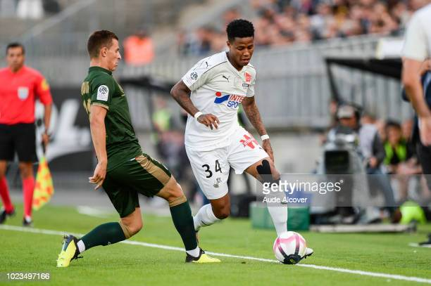 Remi Oudin of Reims and Bongani Zungu of Amiens during Ligue 1 match between Amiens and Reims on August 25 2018 in Amiens France