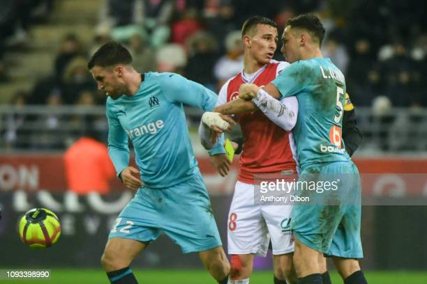 Remi Oudin of Reims and Lucas Ocampos of Marseille during the Ligue 1 match between Reims and Marseille at Stade Auguste Delaune on February 2 2019...