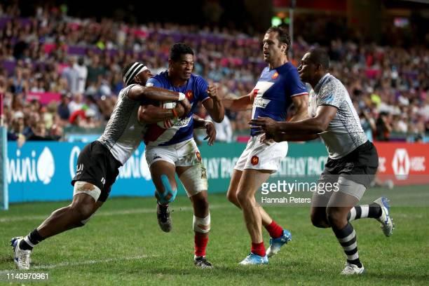 Remi Siega of France charges forward against Fiji on day three of the Cathay Pacific/HSBC Hong Kong Sevens at the Hong Kong Stadium on April 07 2019...