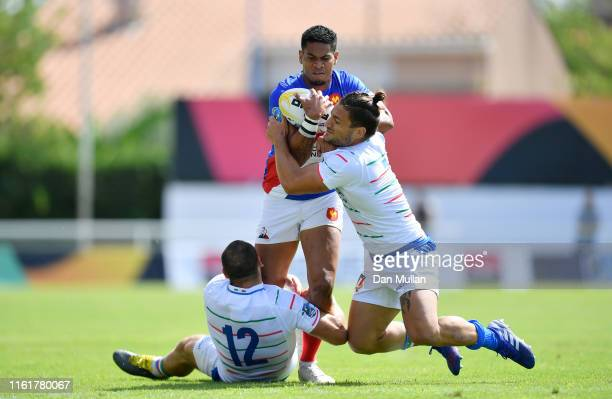 Remi Siega of France is tackled by Gianmarco Vian and Lorenzo Maria Bruno of Italy during the Group A match between France and Italy on day one of...