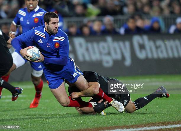 Remi Tales of France is tackled by Ma'a Nonu of New Zealand during the third France vs New Zealand rugby union test match at Yarrow stadium in New...