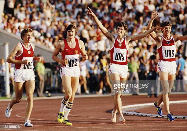 Remigijus Valiulis Mikhail Linge Nikolay Chernetsky and Viktor Markin of the Soviet Union celebrate winning the Men's 4 × 400 metres Relay on 31st...