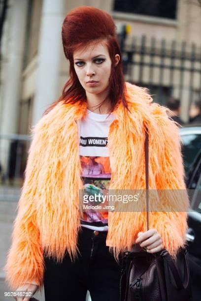 Remington Williams exits the Miu Miu show in the high teased hair by Guido a light orange Sies Marjan Muffy fauxfur jacket Miu Miu tshirt and Coach...