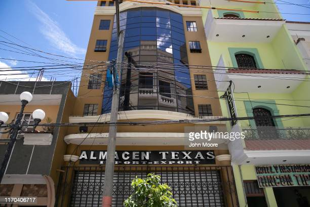 A remittance house stands over a warehouse on August 25 in Salcaja Guatemala Many such homes often sit empty until a time when immigrants choose to...