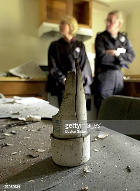 2001 Remnant of pipe bomb that detonated in abandoned military housing at the former Fort Devens sits on table as Middlesex County District Attorney...