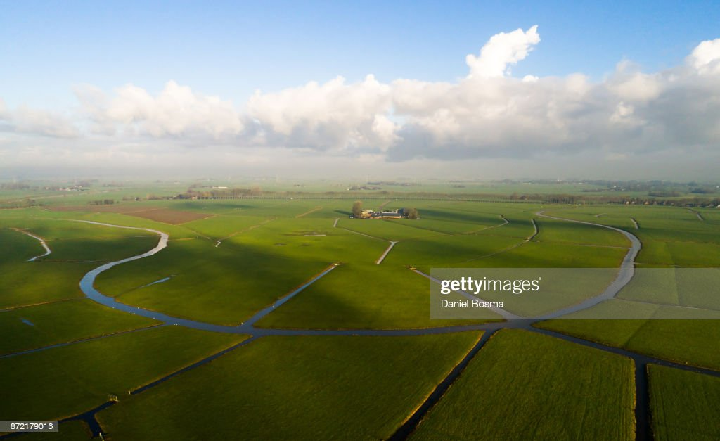 Remnants of a bending river in cultivated Dutch landscape, seen from the air : Stock Photo