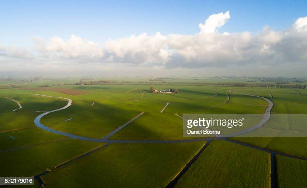 remnants of a bending river in cultivated dutch landscape, seen from the air - groningen province stock photos and pictures