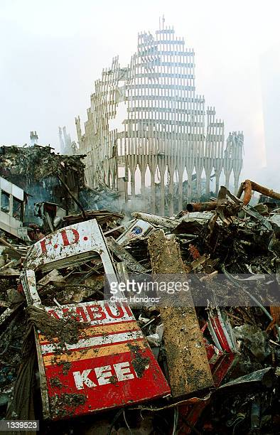 Remnants of a New York City Fire Department vehicle lie in the wreckage of the World Trade Center September 13, 2001 in New York City, two days after...