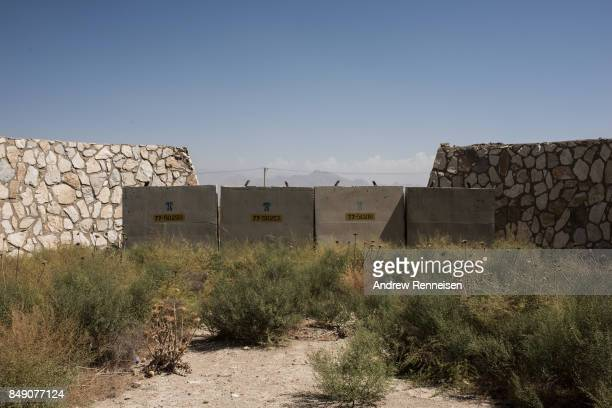 Remnants of dilapidated buildings sit at an unused section of Bagram Air Field on September 5 2017 in Bagram Afghanistan Currently the United States...