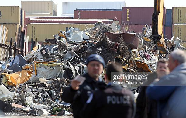 Remnants of school buses are seen in a pile of metal at SRV Metal Scrapper Friday March 8 in Chicago Illinois Buses were reported missing by Sunrise...