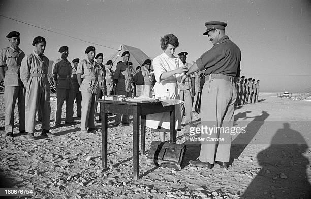 Remnants Of World War Ii In Tobruk Libye Mai 1954 Suites de la deuxième guerre mondiale reportage dans la ville de Tobrouk Infirmière passant en...