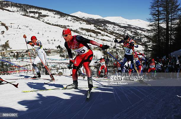 Remo Fischer of Switzerland competes in the Mens Cross Country Skiing 50km Mass Start Final on Day 16 of the 2006 Turin Winter Olympic Games on...
