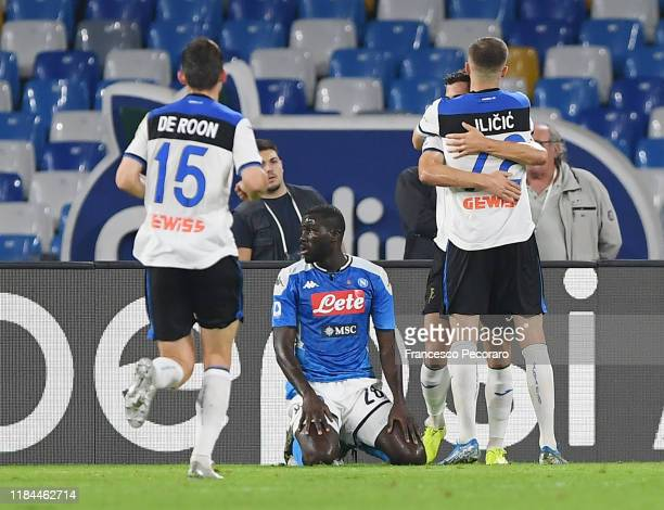 Remo Freuler Josip Ilicic and Marten De Roon of Atalanta BC celebrate the 11 goal scored by Remo Freuler beside the disappointment of Kalidou...