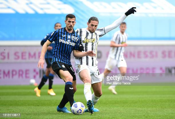 Remo Freuler of Atalanta B.C. Battles for possession with Adrien Rabiot of Juventus during the Serie A match between Atalanta BC and Juventus at...