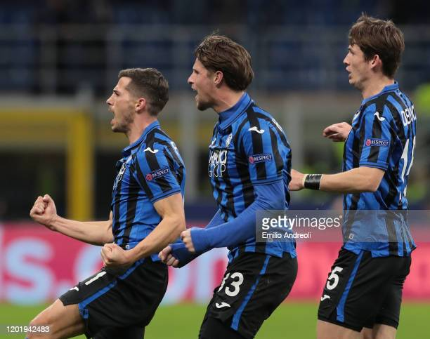 Remo Freuler of Atalanta BC celebrates his goal with his teammates Hans Hateboer and Marten De Roon during the UEFA Champions League round of 16...