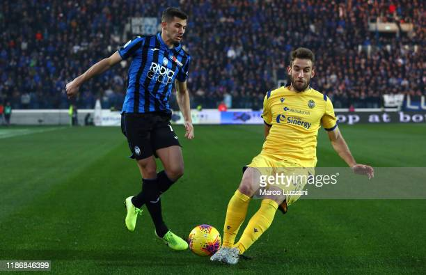 Remo Freuler of Atalanta BC competes for the ball with Alan Empereuer of Hellas Verona during the Serie A match between Atalanta BC and Hellas Verona...