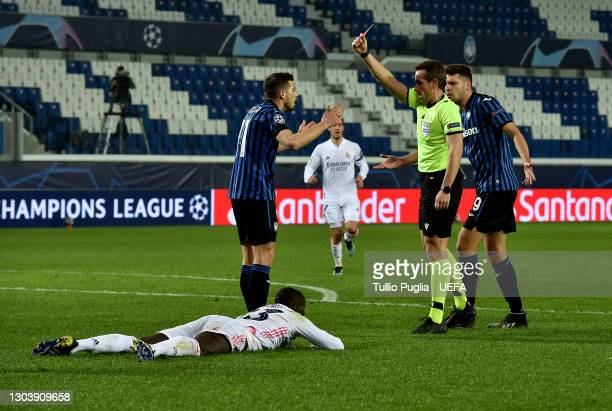 Remo Freuler of Atalanta B.C. Is shown a red card by Referee Tobias Stieler during the UEFA Champions League Round of 16 match between Atalanta and...