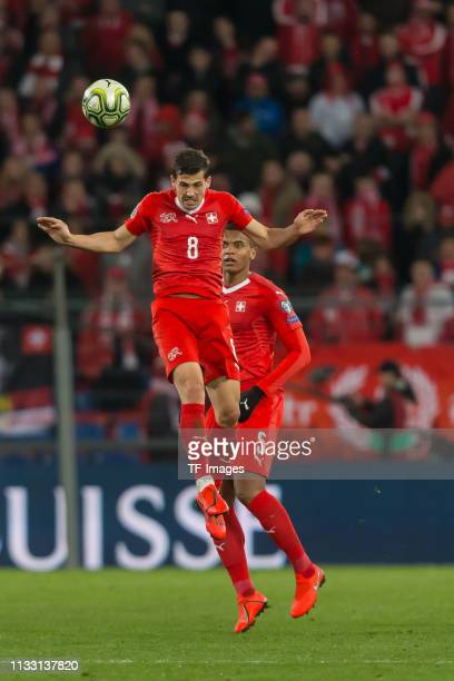 Remo Freuler of Switzerland and Manuel Akanji of Switzerland controls the ball during the 2020 UEFA European Championships group D qualifying match...